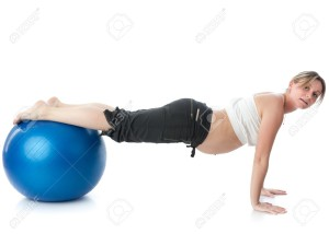 7036987-The-active-pregnant-woman-does-sports-exercises-on-a-white-background-Care-of-health-and-pregnancy--Stock-Photo