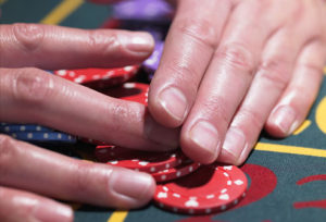 getty_rf_photo_of_hands_gathering_roulette_chips